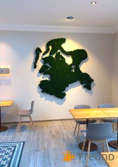 Express your #passion and identity with a #moss wall: The customized shape of #Ruegen for a café in Sassnitz is only one example of what is possible with #preservedmoss by Freund Moosmanufaktur. (Image: Berner Ladenbau)