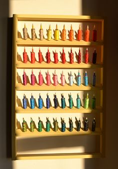 DIY: spool rack, only improvements I'd make would be to add extra pencil chunk for matching bobbins and put in ROYGBIV order, cause the 1% of me that likes order requires it.