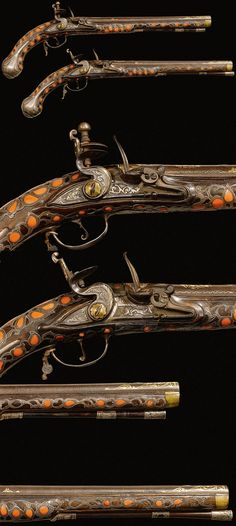 A pair of Ottoman flintlock pistols, 19th century, the steel barrels decorated with gold-overlaid palmettes and stylised foliage, the forestock and grips set with coral.