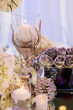 Frozen-Inspired Wedding: Rustic candle holders that are a nod to the loveable reindeer, Sven.