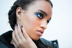 Skin was velvety and perfected, whilst nails were painted an inky hue.