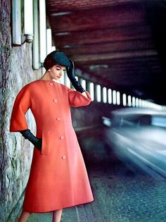 Simone is wearing Dior collarless coat 1957