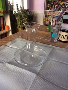 A woman places a plain vase from Walmart on her table. A few steps later? This is gorgeous!