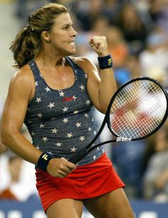 Jennifer Capriati donning a star-spangled top and red skirt at the 2003 US Open.
