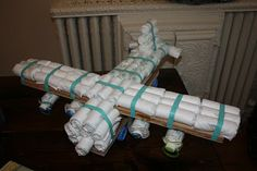 Plane-shaped diaper cake, complete with pacifiers!