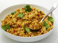 """Thai Coconut Rice""          5 sprigs cilantro      2 tbsp vegetable oil      2 tbsp butter      2 shallots, finely chopped      1 fresh hot red chile, seeded and chopped      4 tbsp Thai red curry paste      2 cups jasmine rice      Grated zest of 1 lime      One 14.5 fl oz (411ml) can coconut milk      1 tsp salt      1 kaffir lime leaf, shredded      2 scallions, white and green parts, thinly sliced"