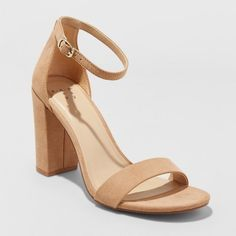e7472ee13 Instantly add a pop of style to any outfit with the Ema High Block Heel  Pumps from A New Day™. These quarter-strap heels bring a classic look with  the.