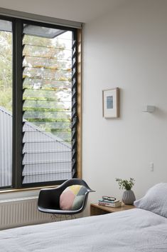"A Family Home in Australia Features a Playful Version of the Classic Pitched Roof - Photo 8 of 9 - A Breezway Louve window brings fresh air into a bedroom. ""Despite their modest size, all spaces feel expansive, thanks to the constant presence of generous windows,"" Porjazoski says."