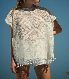 Maya and centro america indigenous women's style white lace huipil. Seam up the front. Club Monaco Beach Report-