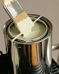 Paint Can Trick Wrap a rubber band around a paint can and wipe your brush on the band and keep the rim of the can clean. Source: Martha Stewart