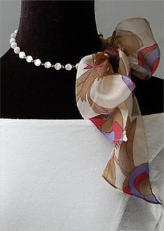 Love the idea of mixing textures in your accessories by tying a scarf or ribbon around your necklace!