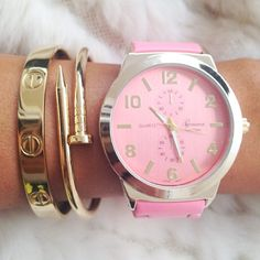 Pink Watch <3 The watch is so cute, but the bracelets are to die for.