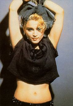 Madonna looks fab while rocking her signature 80's look. The oversized bow, cropped T, and bangles makes this look irresistably awesome!