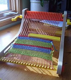 Fisher Price weaving loom -- aka, the absolute best Christmas gift I ever received. A real, working heddle loom. They need to reissue this ASAP.