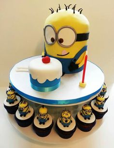 This guy is a little smaller just on a cake stand - could work with 4 9x9 squares with the badges surrounding too.