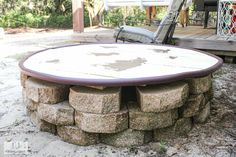 Learn how we DIY'ed an outdoor table to hide a grinder pump well. This is a functional outdoor table that also allows you to access the grinder pump. Outdoor Table Tops, Outdoor Decor, Diy Fizzy Bath Salts, Mason Jar Candles, Diy Tv, Wood Slab, Furniture Makeover, Paint Furniture, Diy Table