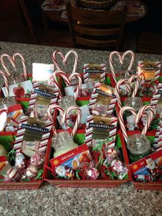 Christmas baskets for staff. Small Yankee candles with a gift card hot glued on candy canes hot glued together to make a heart and some fun Christmas treats hidden inside. Small treat trays were bought in a three pack and red and green confetti was place Christmas Gift Baskets, Teacher Christmas Gifts, Homemade Christmas Gifts, Christmas Fun, Teacher Gifts, Holiday Gifts, Fun Gifts, Christmas Thank You Gifts, Small Christmas Gifts