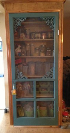 Old screen door turned pantry! This is what I wanted to do with my old screen door but it doesn't fit the door space. Old screen door turned pantry! This is what I wanted to do with my old screen door but it doesn't fit the door space. Old Screen Doors, Diy Screen Door, Old Doors, Screen Door Pantry, Pantry Doors, Vintage Screen Doors, Screen Door Decorations, Screen Door Closer, Painted Screen Doors