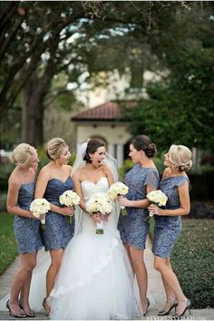 bride laughing with bridesmaids in short lace dusty blue dresses