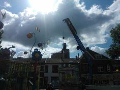 Hangaing man setting up the 'kermis' (carnaval) in tilburg