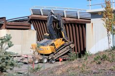 Total carnage as Deere hits a railway bridge | Construction Digger Blog | The Construction Index