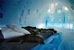 Ice Hotel in Jukkasjarvi, Sweden - I hate the cold, but I would love to stay there. It looks so cozy and warm even with the below zero temps.