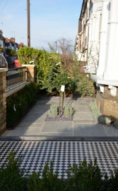 Victorian black and white mosaic brick wall yellow red rail wrought metal Yorkstone caps and entrance stone London Mayfair Westminster Kensington Mayfair Fitzrovia Marylebone London Contact anewgarden for more information Small Front Garden Ideas Uk, Small Front Gardens, Victorian Front Garden, Front Path, Manor Garden, London Garden, House Front, Brick Wall, Garden Inspiration