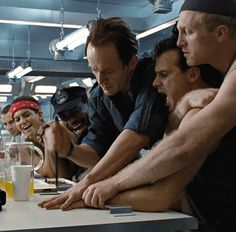Aliens (1986). L to R: Private Wierzbowski is played by Trevor Steedman, Private Vasquez, in the red bandana, is played by Jenette Goldstein, Sergeant Apone is played by Al Matthews, Bishop, an android, is played by Lance Henriksen, Private Hudson is played by Bill Paxton, and Private Drake is played by Mark Rolston.