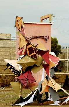 Clemens Behr. He creates geometric installations with the help of cardboard and tape.