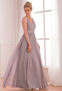 Brides: B2. Elegant and stylish this dress can fit into any bridal party. This Poly Chiffon bridesmaid gown features a portrait neckline and an A-line skirt. Tasteful ruching along the bodice gives the classic silhouette a modern twist.