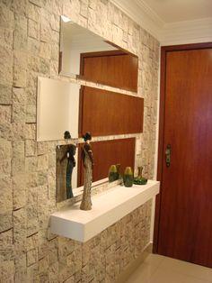 Image result for aparadores modernos para hall de entrada em parede de pedra