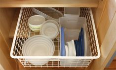 Container Store's medium width, 2-runner Elfa drawer, attached to an easy glide track.  Corral lids in a separate plastic container within the drawer.