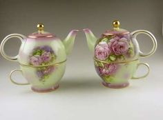 """Pair of vintage Victorian style """"tea for one"""" tea pots with nesting tea pot in oversized tea cup in the """"Victoria's Garden"""" pattern.  These lovely tea pots have applie..."""