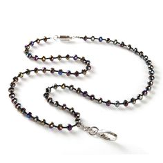 Both tiny and large round iridescent beads make up the Lizzie. This charming piece conveniently doubles as a fashion lanyard and a cute necklace. Wear it with the hook attached during the day to safely hold your ID card and then remove the badge holder to wear it as an accessory.