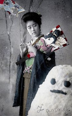 "Bijin with Hagoita Paddle and Snowman 1907    This is a Meiji Era, hand-coloured postcard. Across the snowman is written the girl's name ""Fanny""."