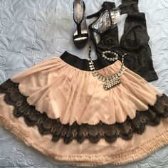 Chic lace skirt  Perfectly chic lace detail skirt.  Beautiful  new condition                                                                        ✅will bundle  ✅ all reasonable offers will be considered  ✅ No Trading  Poshmark rules only‼️ Not all sizes are the same measurements Measurements taken laying flat                            Ⓜ️Waist 15. Stretch up to 18                                                                               Ⓜ️Length 21 Forever 21 Skirts Midi