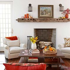Fall decorating can be as simple as swapping your present living room essentials for decor in crisp colors. A burnt orange blanket and coordinating pillows spice up this homey room. Gourds, along with seasonally appropriate flowers and leaves, garnish the coffee table and the rustic wooden mantel./