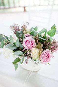 Eucalyptus make this pastel pink cream and purple rose arrangement really pop.  / D'amor Photography http://ift.tt/1OBaYDF