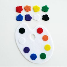 The Color Matching Painters Palette felt board learning set was designed to help young children learn and explore colors in a fun way.  These