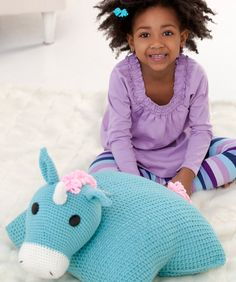 Pillow pals are a unique way for a child to have a stuffed friend that is also a pillow. The fantasy unicorn is perfect for a little girl's imaginary play. Crochet him in her favorites colors.