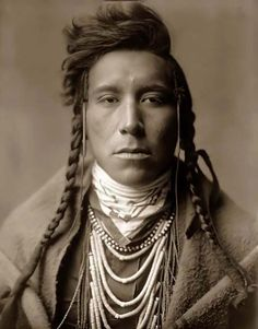 Here for your consideration is an old picture of Bird On High Land, a Crow Indian Boy. It was created in 1908 by Edward S. Curtis.