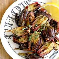 Roasted baby artichokes infused with lemon, shallots and thyme are extremely easy to make and finger-licking good.