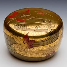 Asian Art | Harui Kōmin 春井恒眠 - Tea Caddy with Maple Leaves over the Tatsuta River - The Curator's Eye