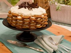 Chocolate-Chip-Cookie Icebox Cake  Can use store bought cookies.  Great for the gathering with aunts, uncles, & cousins.