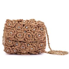 Floral Raffia Baguette - The gold flowers centered with crystals makes it ideal for those special and dressy occasions, be it your gowns, or colorful attires. The baguette is a gorgeous yet elegant hand piece that has been designed for every occasion! http://www.ruchehues.com/collections/dressy-affair/products/gold-floral-raffia-baguette