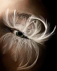 White feather eye lashes. Lower eye lashes. Fantasy make up. Costume make up. Exotic eyes