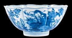 A Chinese blue and white bowl, Kangxi period , with fluted sides, flared mouth and foliated rim, the eight panels to the exterior painted with peonies, narcissi and lingzhi funghi, the well with a medallion depicting two butterflies hovering above flowers and reeds growing on a rock, the base with a six character mark of Xuande within a double ring, 16cm dimeter 7 cm high