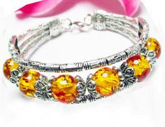 This is a Nice Tibet Silver yellow color beaded bangle bracelet with an adjustable clasp.