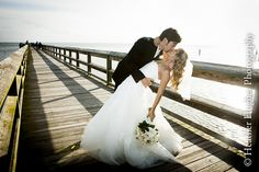 Love this wedding portrait on a small fishing pier in Newport News by Heather Hughes Photography!