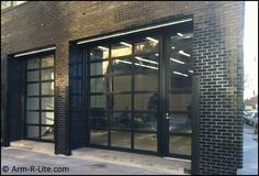 Advanced Door Sales NJ installed an Arm-R-Lite glass garage door fixed transom and matching entrance door at the Willardt Gallery. & Marlborough Chelsea Gallery with two welded aluminum and glass ...
